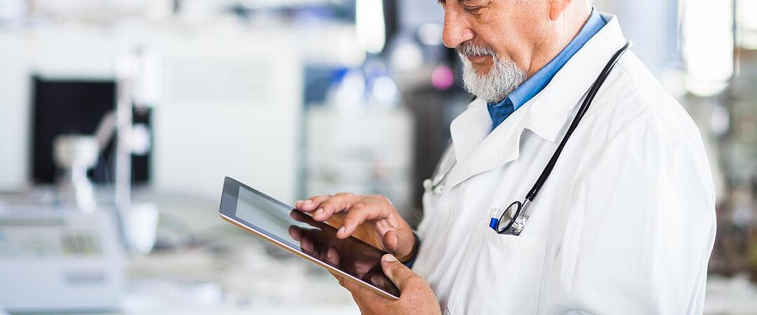 Healthcare-Doctor-using-tablet