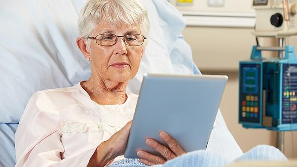Patient-Using-Tablet.jpg