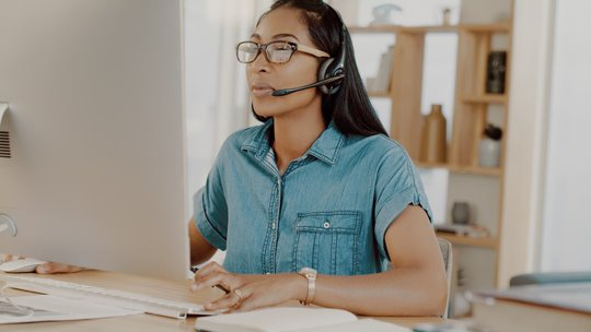 RingCentral-Woman with headset at desk